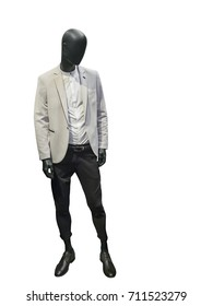 Full length male mannequin dressed in white coat and black trousers, isolated on white background. No brand names or copyright objects.