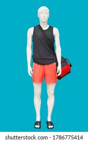 Full length male mannequin wearing sport athletics clothes over blue background. No brand names or copyright objects.