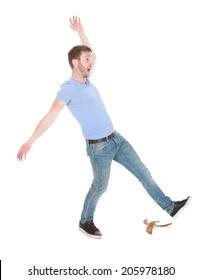 Full length of man slipping over white background