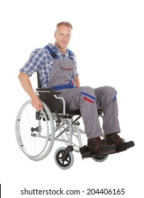 Full length of manual worker in wheelchair over white background