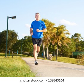 Full length of a mature man jogging. Horizontal shot.
