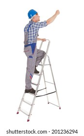 Full length of mid adult repairman climbing step ladder over white background