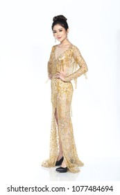 Full Length of Miss Beauty Pageant Contest woman in yellow gold sequin Evening Ball Gown long dress, high fashion model make up hair style, studio lighting white background isolated