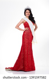 Full Length of Miss Pageant Contest in Asian Red Sequin Evening Ball Gown dress with Silver Diamond Crown Sash, fashion make up face hair style, studio lighting white background isolated copy space