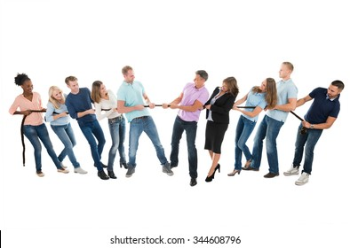 Full length of multiethnic creative business teams playing tug of war against white background