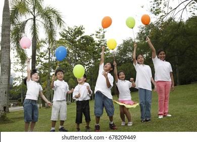 Full length of multiracial kids