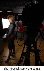 full length news reporter in television studio before transmission