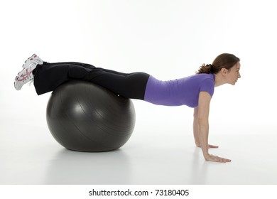 Full length photo of attractive woman exercising on  ball