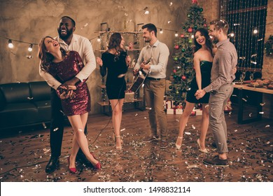 Full length photo of charming couple dance and fellows play sing in karaoke enjoy christmas party x-mas holidays  in house indoors