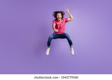 Full length photo of cool crazy young guy dressed pink outfit jumping riding horse isolated purple color background