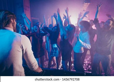 Full length photo of crazy fellows have event dancing raise hands arms wear dress suit formal wear disco discotheque