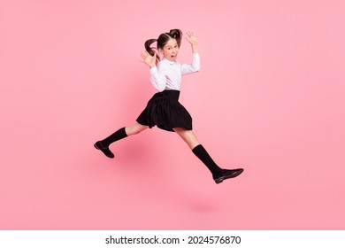 Full length photo of crazy happy cheerful girl jump up walk empty space cool isolated on purple color background