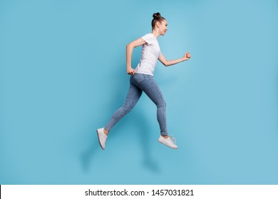 Full length photo of excited lady hurrying shopping wear white casual t-shirt jeans denim isolated blue background