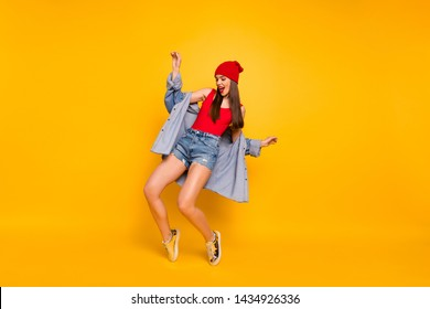 Full length photo of funny amazing lady dancing modern moves stand on toes street style wear red body tank-top denim shorts blazer