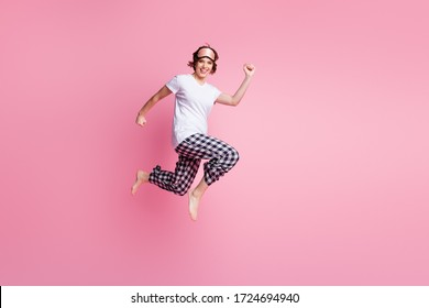 Full length photo of funny lady jump high up rush low prices shopping didn't change sleep clothes wear mask white t-shirt plaid pajama pants barefoot isolated pink color background