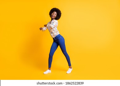 Full length photo of funny sweet dark skin woman wear casual outfit dancing isolated yellow color background - Shutterstock ID 1862522839