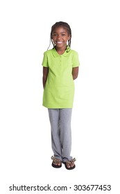 Full length photo of a happy school aged child, isolated on white