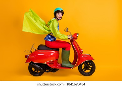 Full length photo portrait of excited girl riding bike isolated on bright yellow colored background
