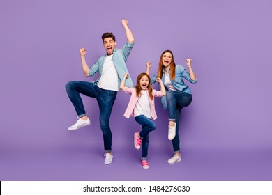 Full length photo of rejoicing dad mom and little foxy lady cool win wear casual clothes isolated purple background