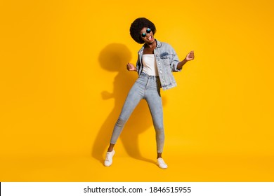Full length photo of shiny lovely young lady wear casual denim outfit smiling dancing isolated yellow color background - Shutterstock ID 1846515955