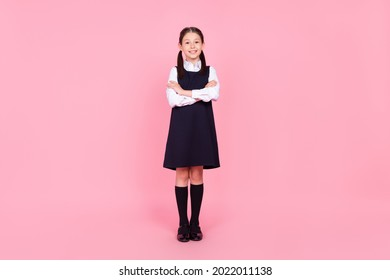 Full length photo of young school girl happy positive smile confident folded hands isolated over pink color background