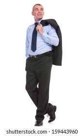 full length picture of a business man holding his jacket over his shoulder and a hand in his pocket while looking away from the camera. on a white background