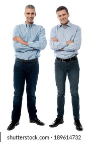 Full length picture of a casual men, arms folded