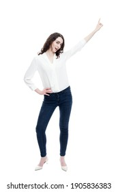 full length picture of a casual young woman standing with her hands on her hips and smiling to the camera. isolated on white background