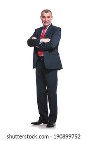 full length picture of a mid aged business man smiling with his arms crossed. isolated on a white background