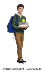 Full length picture of a schoolboy holding books