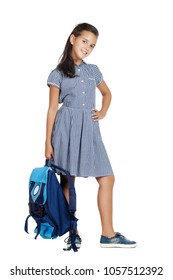 Full length picture of a schoolgirl in a  dress with a bag in her hand