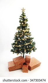 full length plastic christmas tree simply decorated with gold ornaments and tinsel gold star - White Fake Christmas Tree