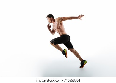 Full length portrait of active young muscular running man, isolated over white background