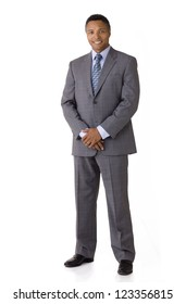 Full length portrait of an African American businessman smiling wearing a suit and tie isolated on a white background