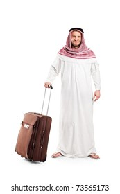 Full length portrait of an Arab tourist carrying a suitcase isolated against white background