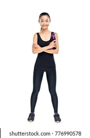 Full length portrait of Asian woman holding bottle of water. Fitness girl in black sportswear standing with arms crossed and sipper plastic bottle. Isolated photo of female young sporty model