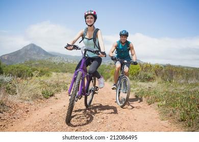 Full length portrait of an athletic couple mountain biking