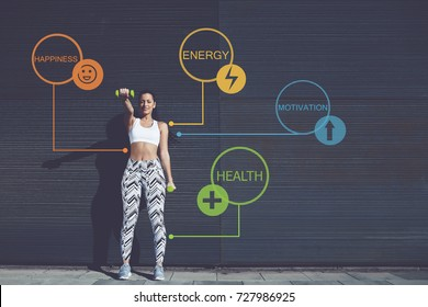 Full length portrait of athletic young woman lifting weights standing with arms tense against black wall outdoors, female working out training bicep. Infographics elements with sport health benefits