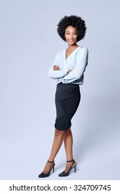 Full length portrait  of attractive young black african model wears smart business attire in studio and smiling