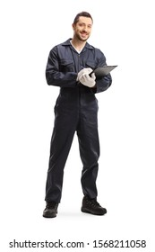 Full length portrait of an automechanic standing with a clipboard isolated on white background