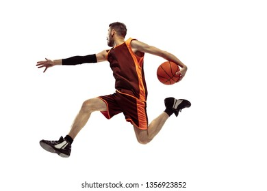 Full length portrait of a basketball player with ball isolated on white background. Advertising concept. Fit caucasian athlete jumping at studio. Motion, activity, movement concepts.