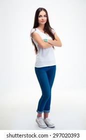 Full length portrait of a beautful happy woman standing with arms folded isolated on a white background. Looking at camera