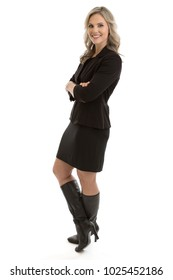 Full length portrait of a beautiful blond mid 30s businesswoman wearing a black suit and thigh high boots isolated on white