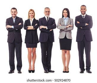 Full length portrait of beautiful business people in suits looking at camera and smiling while standing with folded arms on a white background