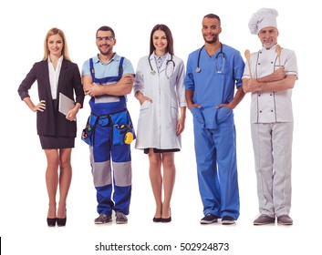 Full length portrait of beautiful people of different professions in uniforms looking at camera and smiling, isolated on white