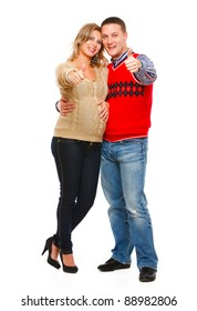 Full length portrait of beautiful pregnant woman with husband showing thumbs up isolated on white