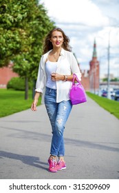 Full length portrait of a beautiful woman in blue jeans