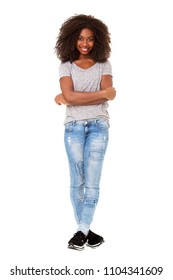 Full length portrait of beautiful young african american woman standing with her arms crossed on white background