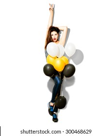 Full length portrait of Beauty fashion model girl with colorful balloons isolated on white background. Party, holiday celebration. Beautiful woman