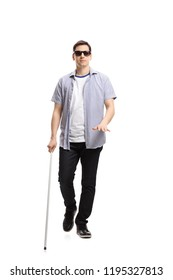 Full length portrait of a blind man walking isolated on white background